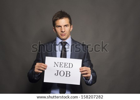 Fired businessman searching for a job isolated on gray background