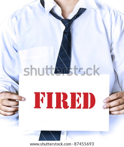 "fired employee holding ""fired"" sign in hand"