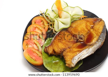 fired fish with fish sauce ,on white background