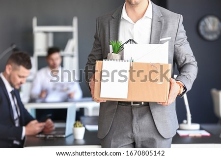Fired man with personal stuff in office Сток-фото ©