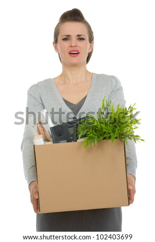 Fired woman employee holding box with personal items