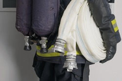 firefighter carries equipment for extinguishing fires, close-up