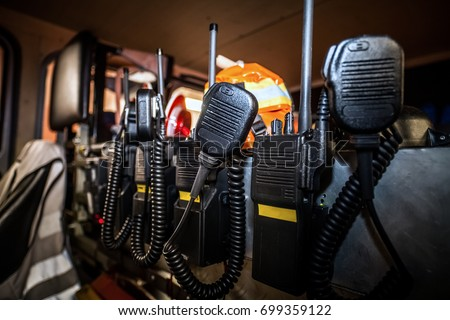 Firefighter equipment in a fire truck with walkie talkie and halt stop trowel