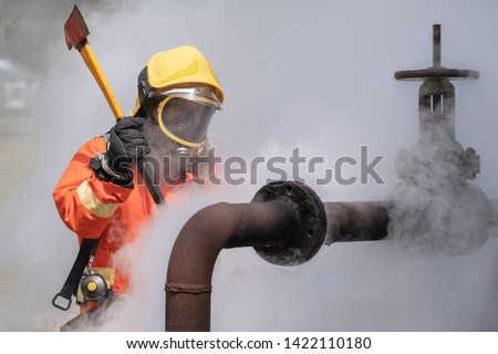 Firefighter Fireproof Orange suit Pipe cutting gas LPG Combustible Gas pipeline leaks at the joints with the valve Spark and Fire on the gas  explosion at the gas pipeline Fire protection alarm Safety