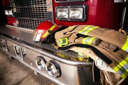 Firefighter gear on truck bumper