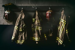 Firefighter hanging suit in a dark room