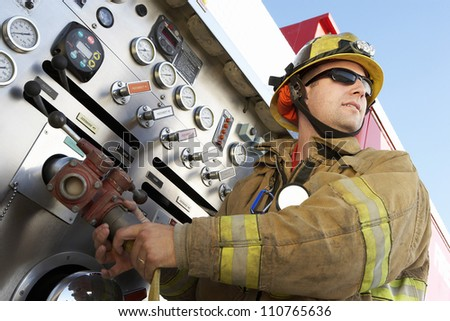 Firefighter holding hose