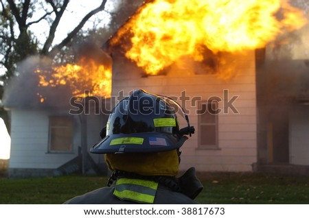 firefighter in foreground of fire