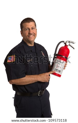 Firefighter in uniform holding fire extinguisher pointing to instruction on isolated white background