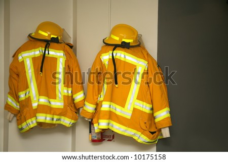 Firefighter jackets and helmets hanging in the fire station