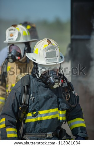Firefighter leaving a building after putting out the fire.
