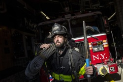 Firefighter prepared in front of the fire truck