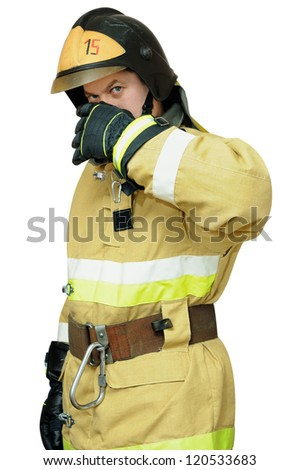 Firefighter protects the face with one hand. Isolated on white background