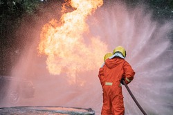 Firefighter Put on a suit Orange Extinguish Car oil fire oil spillage hydrant From accident Car crash prevent practice Safety 3 people Control Blackout alarm blaze assistance heat putting out