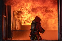Firefighter Put on a suit Orange Extinguish Car oil fire oil spillage hydrant From accident Car crash prevent practice Safety people Control Blackout alarm blaze assistance hea Orange In the contain