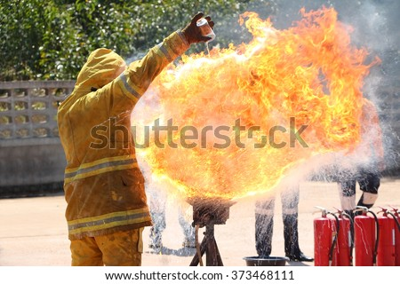 Firefighter showing the severity of the spontaneous combustion of vegetable oil in a frying pan.