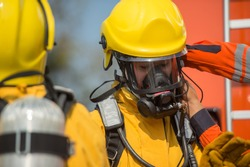 firefighter training with oxygen mask suit
