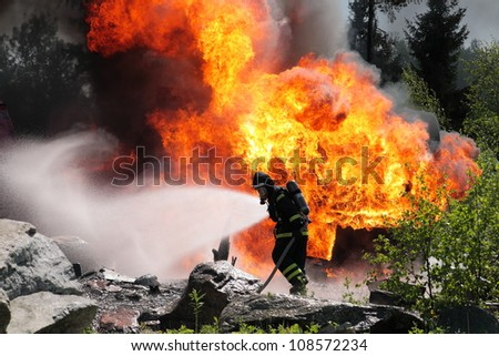 Firefighter trying to put out a fire in Sweden.