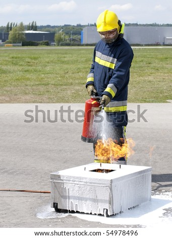 Firefighter using fire extinguisher