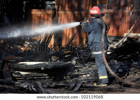 Firefighter using hose