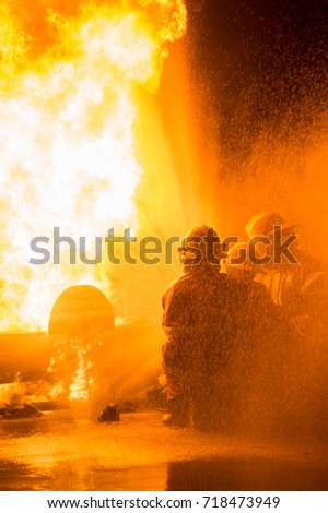 firefighter with fire background
