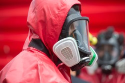 firefighter with hazmat (hazardous material) suits to protect them from danger chemical work on the accident road