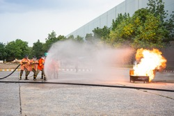 Firefighters attack fire during a training exercise.