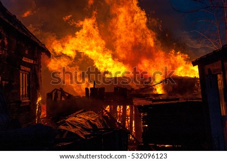 Firefighters extinguish a house;  stock photo
