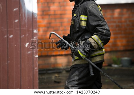 firefighters extinguish the fire house