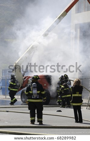 Firefighters extinguishing fire in building - a series of FIRE images.