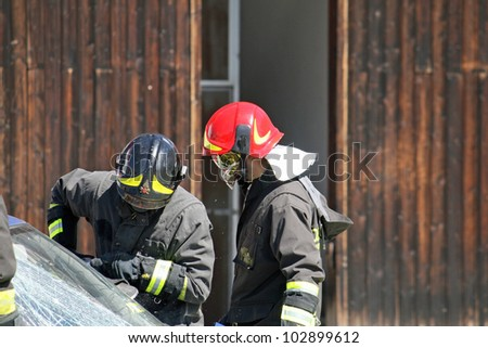 firefighters in action to free the injured in an accident