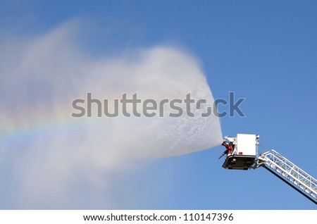Firefighters on using large volume appliance water delivery - stock photo