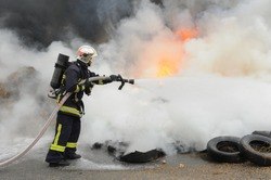 firefighters putting on a fire at a demonstration