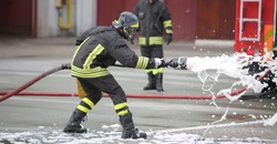 Firefighters while extinguishing the fire with a special fire extinguishing equipment with foma
