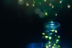 fireflies in a glass jar on a dark background