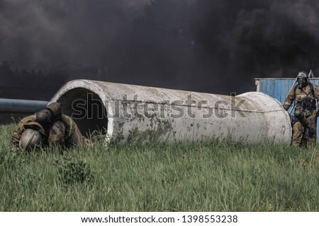 Fireman crawls out of a white pipe passing a fire strip
