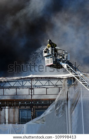 Fireman extinguishing fire on a building, Oslo, Norway