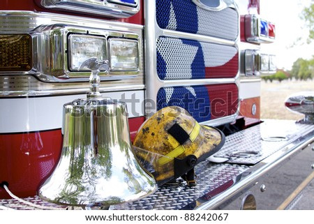 fireman helmet on the front bumper of a fire engine