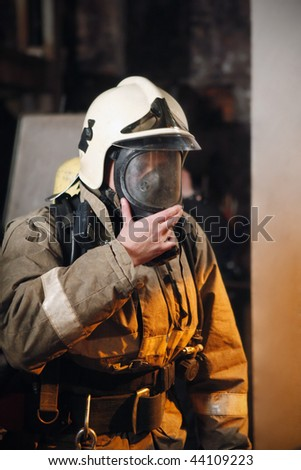 Fireman in fire protection suit and mask