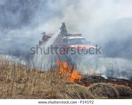 Fireman putting out brush fire