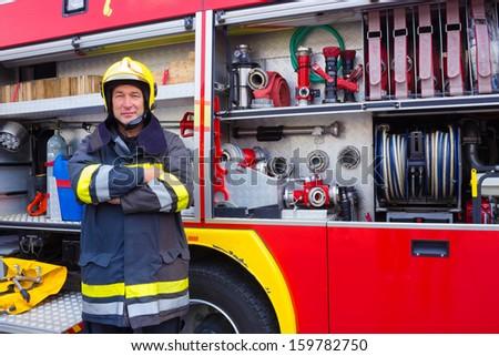 Fireman standing by fire engine, Fireman, photography