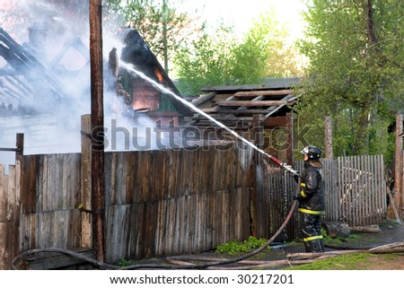 fireman struggles with fire
