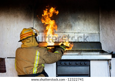 Fireman trying to put an oil fire out with a chopping board