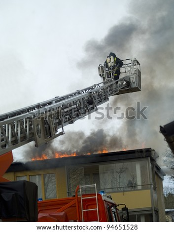 Fireman working on top of a ladder