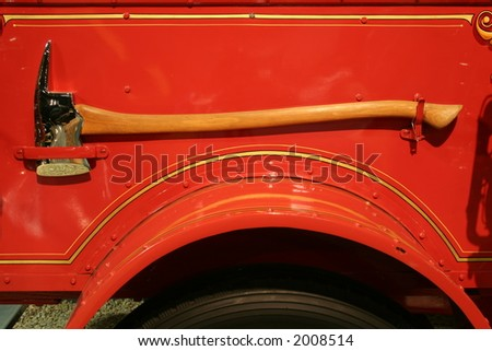 firemans' axe on side of vintage fire engine