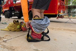 Firemen are wearing firefighter's suit, starting with their shoes first.