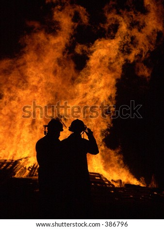 Firemen controlling a fire. - stock photo
