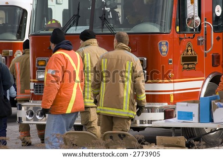 firemen on background of firetruck