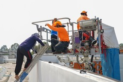 Firemen preparing a fire escape device that use as vertical escape chute for high rise buliding