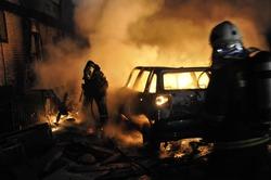Firemen putting aut fire in car